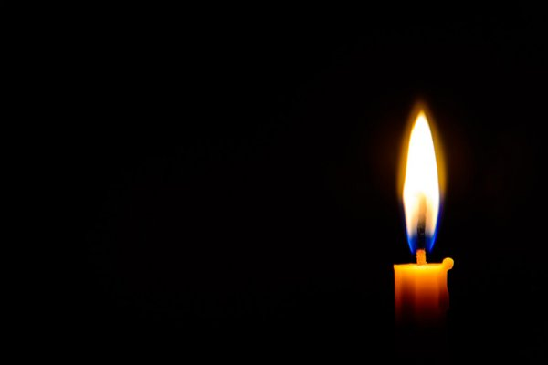depositphotos 59720475 stock photo candle light in the dark